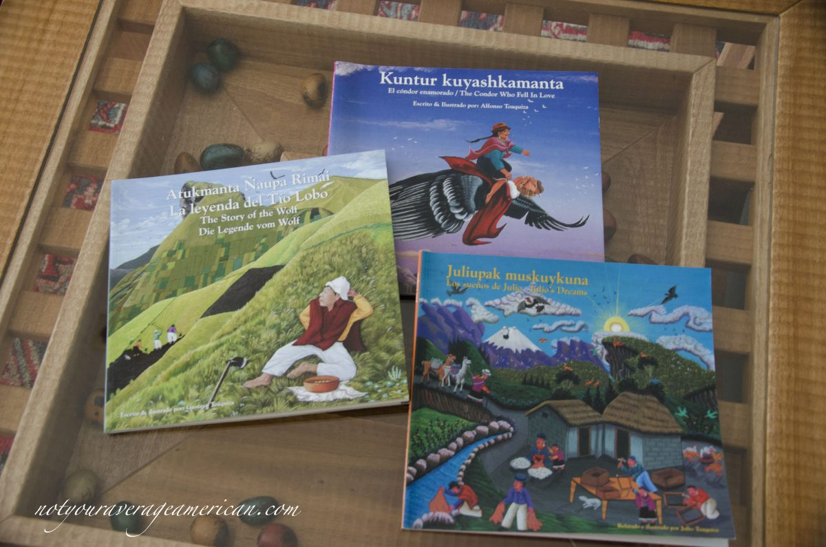 Three books with artwork from Tigua by the Toaquiza family.