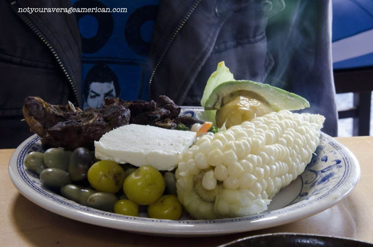 Asado de Borrego came with grilled mutton, a large boiled potato, smaller tubers that are potato-like, sliced avocado, a fresh salad of broccoli, beans, and carrot, habitas (fava beans) and fresh cheese, and the ever popular ear of corn called choclo.