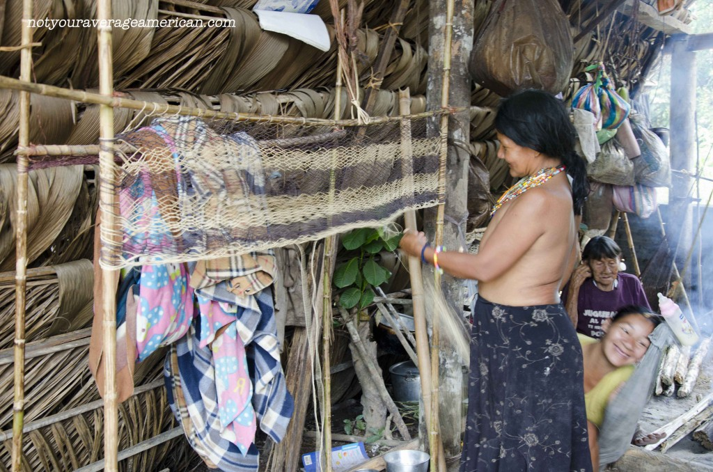 The Huaorani harvest fiber from the jungle, turn it into rope, and then use it to make other items. This woman is working on a soon-to-be hammock.