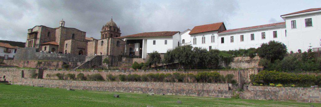 The ancient stone walls of Qoricancha at the base of Santa Domingo