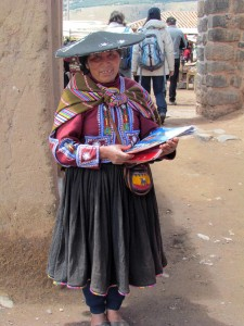 A local woman handing out tourist guides.