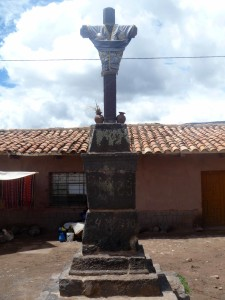 The dressed cross in the town plaza at Raqchi.