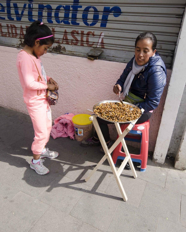 Catzos Vendor in Otavalo, Ecuador | ©Angela Drake