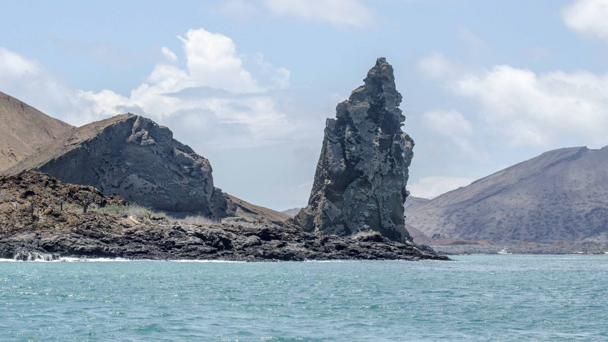Pinnacle Rock, looking from Bartolome towards Santiago Island, the Galapagos.