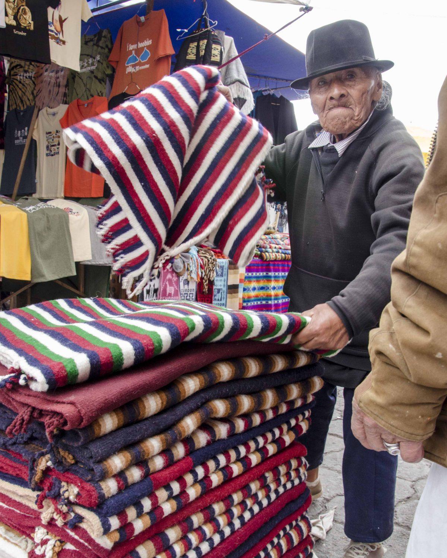 Vendor Selling Woolen Ponchos, Otavalo, Ecuador