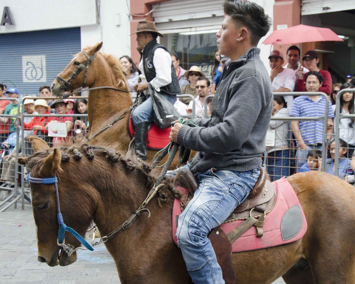 A young man and his horse in the Cacería del Zorro Parade, Ibarra, Ecuador | ©Angela Drake