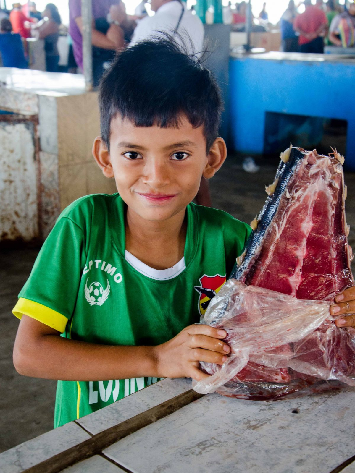 A young Manteño proudly displays his family's tuna for sale, Ecuador | ©Angela Drake / Not Your Average American