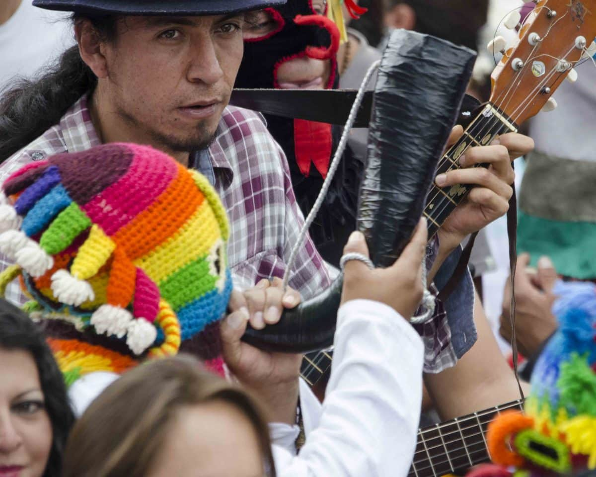 Horns and Guitar, Inti Raymi, Parade of Schools, Cotacachi, Ecuador | ©Angela Drake