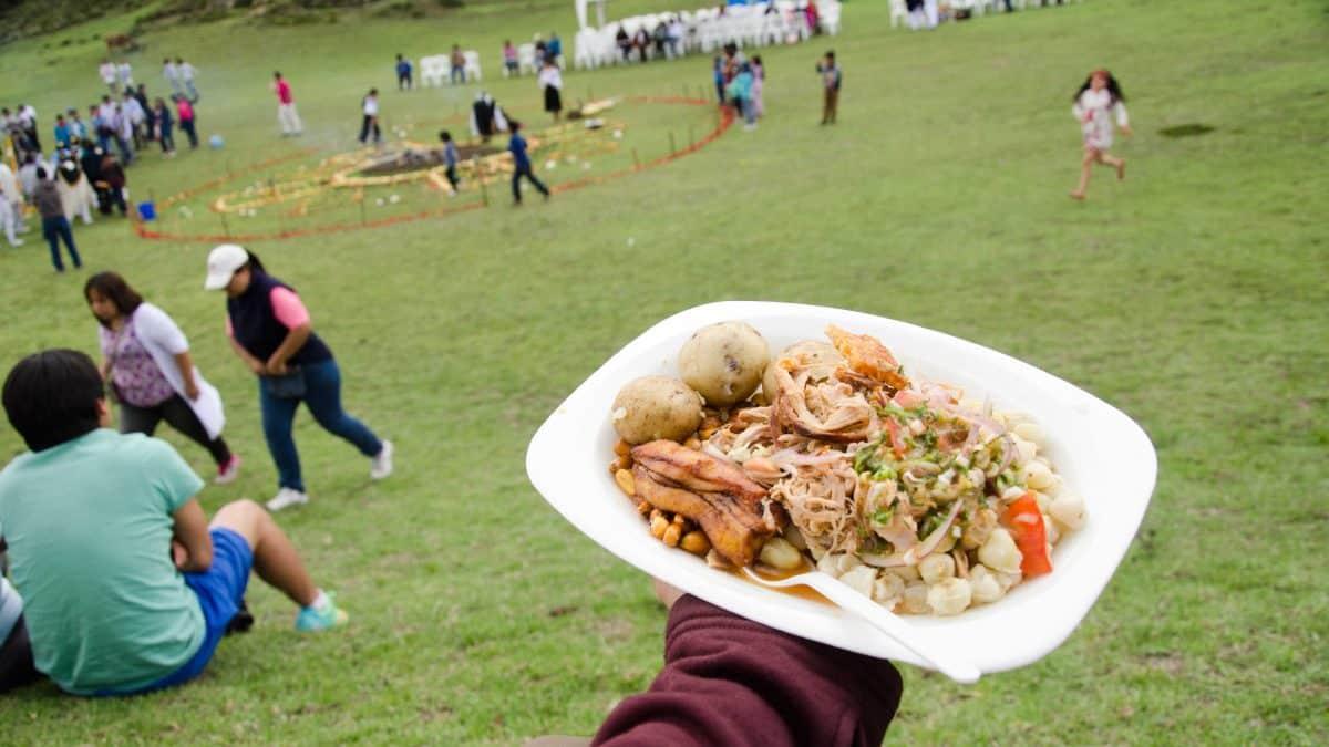 A plate of delicious hornado, Mushak Nina festival, Cochasquí, Ecuador   ©Angela Drake