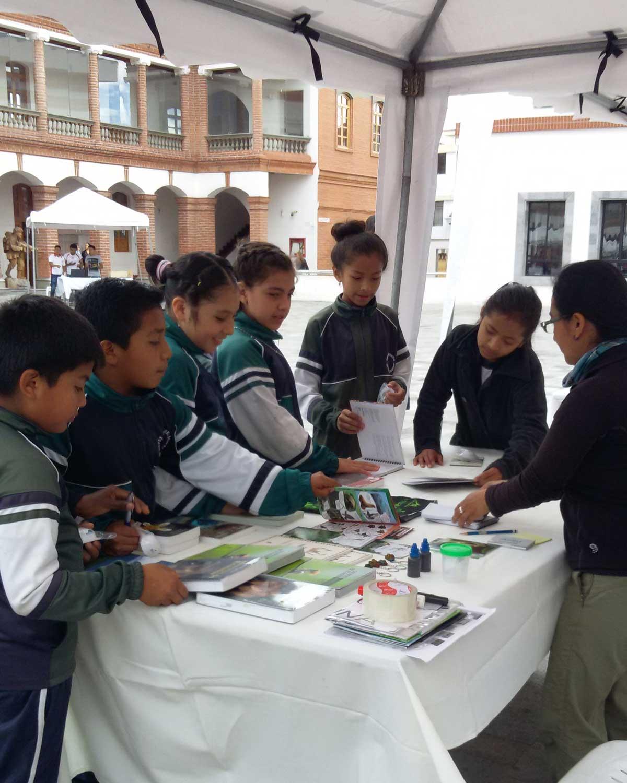 Ecuadorian Children Admiring the Field Guides