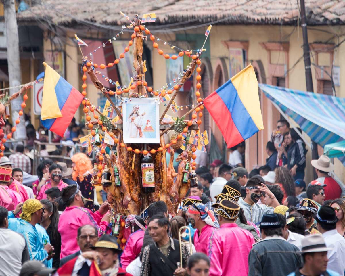 El Ashangero Carrying the Ashanga, Mama Negra, Latacunga, Ecuador | ©Angela Drake