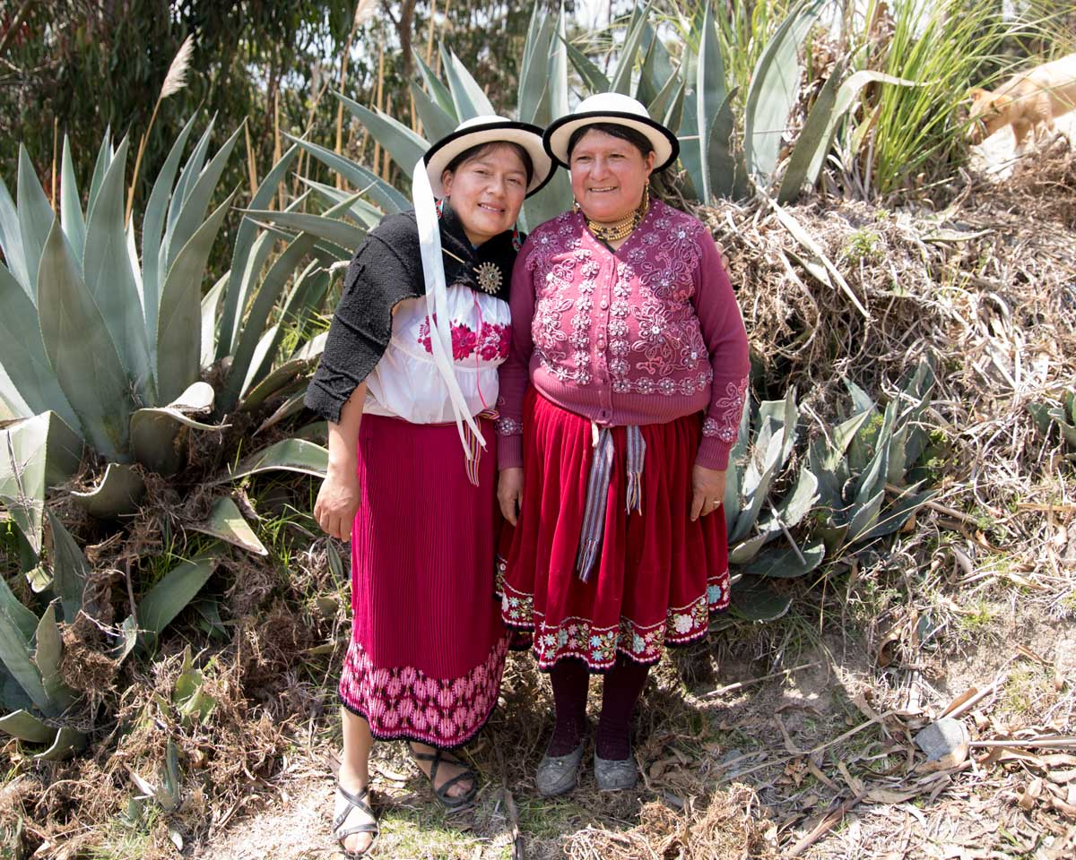 Tamia and her Mother wear bright clothes typical in the Cañar Province of Ecuador  ©Angela Drake