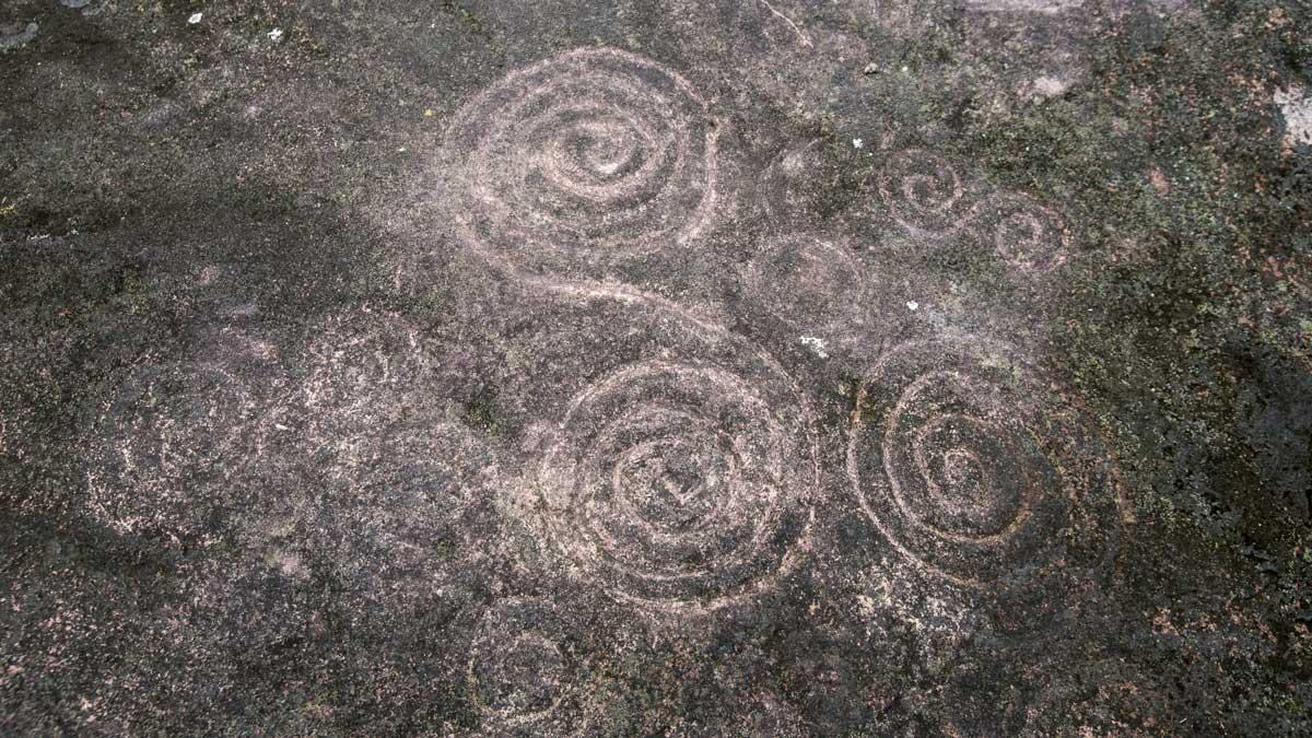 Spiral Petroglyphs in Guizhaguiña, Cascada Plano Rumi, Ecuador | ©Angela Drake
