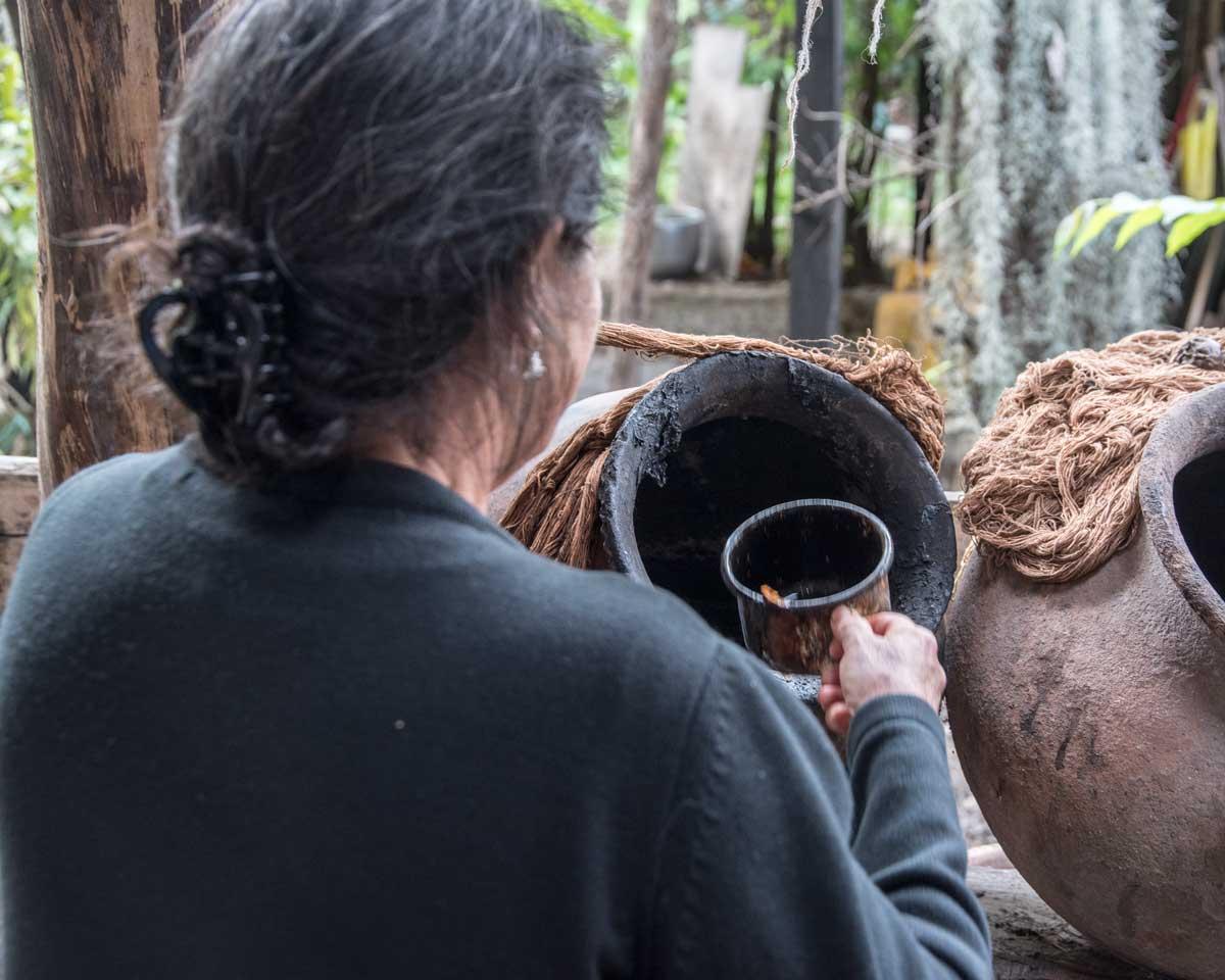 Scooping Indigo Blue for dying macana fibers; La Casa de la Macana, Gualaceo, Ecuador   ©Angela Drake