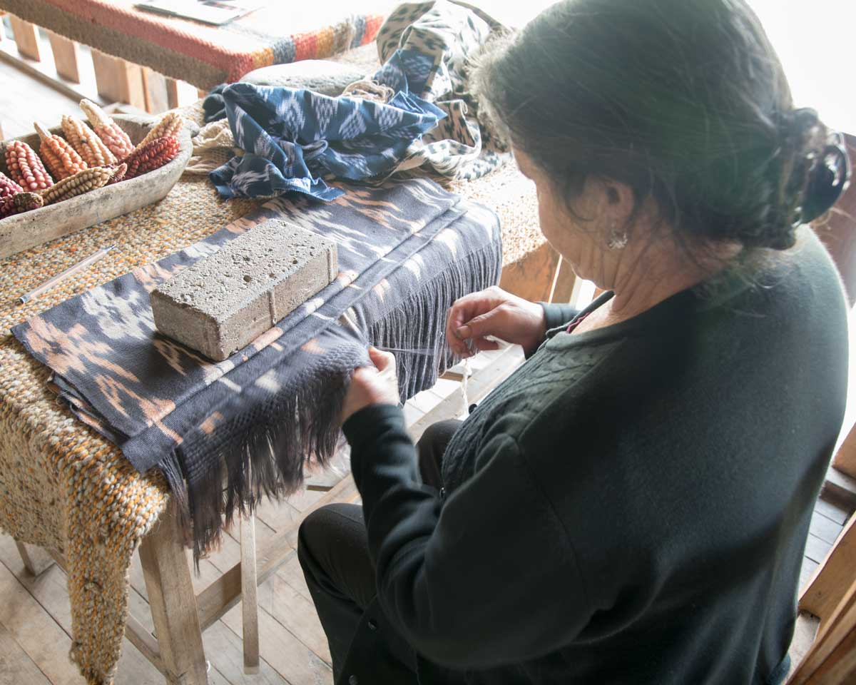 Ana María Ulloa demonstrates hand weaving; La Casa de la Macana, Gualaceo, Ecuador   ©Angela Drake
