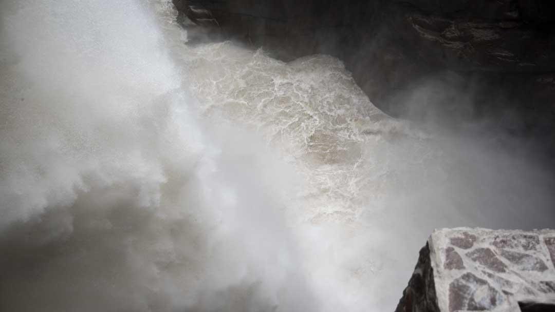 Water pouring into the Devil's Cauldron, (Pailon del Diablo), Rio Verde, Ecuador | ©Angela Drake
