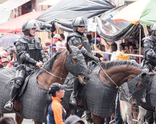 Police on horseback; Mama Negra Parade, Latacunga, Ecuador | ©Angela Drake