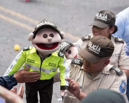 Police with Puppets; Mama Negra Parade, Latacunga, Ecuador | ©Angela Drake